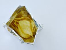 Истинската причина пакетите с чипс да са наполовина празни