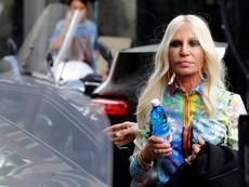 Майкъл Корс купува Versace
