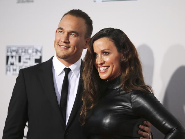 Аланис Морисет и съпругът ѝ Марио Тредуей. Снимка: Reuters